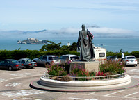 Statue of Christopher Columbus with Alcatraz